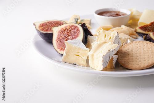 Fototapeta cheese plate with fruits