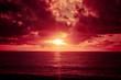 Leinwanddruck Bild - Colorful sunset over ocean