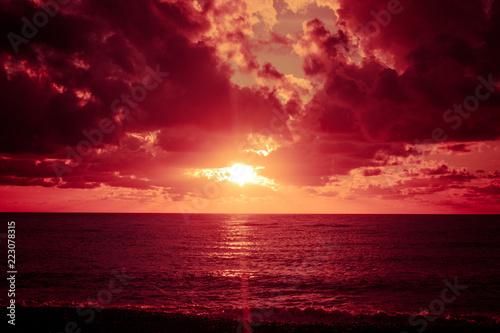 Leinwanddruck Bild Colorful sunset over ocean