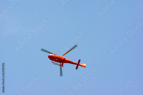 Fototapeta Red Helicopter Low