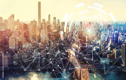 Leinwandbild Motiv Digital Tech Circle with the New York City skyline near Midtown