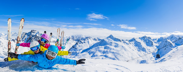 Happy family enjoying winter vacations in mountains . Ski, Sun, Snow and fun.