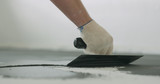 closeup male worker applying micro concrete plaster coating on the floor with a trowel - 223122727