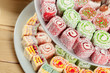 Turkish delight on a wooden table. - 223125523