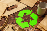 Eco concept with recycling symbol on table background top view - 223125566