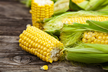 Ripe corn on a wooden table.