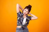 Sleepy young Asian woman yawn in tropical shirt - 223126758