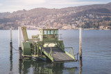 Industrial barge floats on the Como lake - 223130944