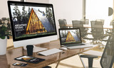 computer, laptop, tablet, and phone with architect studio website at office mockup - 223155711