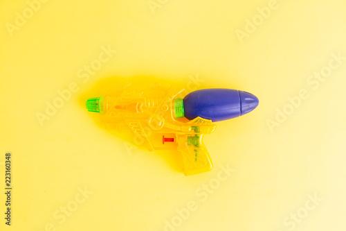Leinwandbild Motiv water gun on colorful background