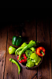 various harvested peppers and hot peppers in basket - 223165112