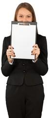 Portrait of pretty young woman in black shirt holding clipboard © BillionPhotos.com