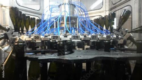 Washing line for bottles and bottling of champagne conveyor at the factory © Aleksandr Kurganov