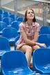 young fashion girl watching film in cinema