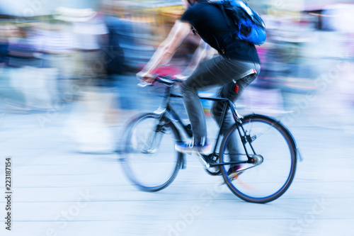 bicycle rider in the city in motion blur - 223187154