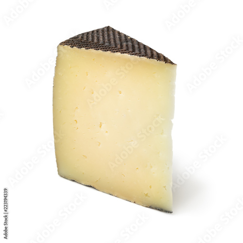Fototapeta Wedge of Spanish Manchego cheese