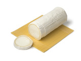 Roll of soft white organic goat cheese and slice - 223194548