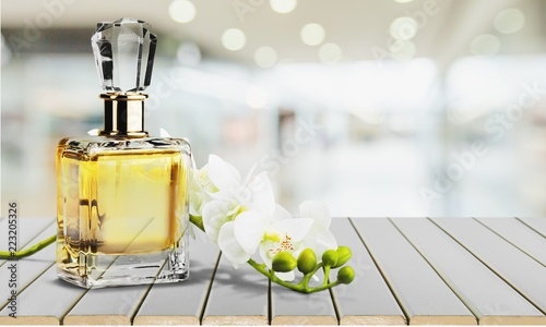 Leinwandbild Motiv Perfume bottle and flowers isolated on  background.
