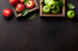 Green and red apples in wooden box - 223217991