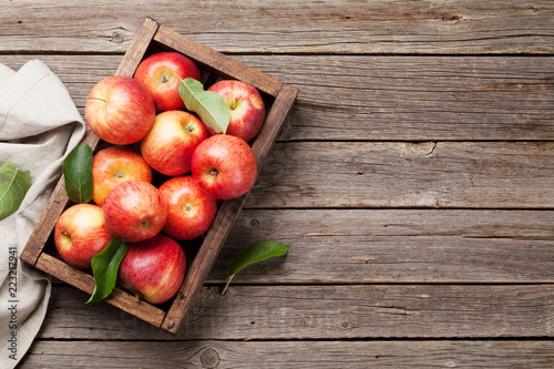 Red apples in wooden box - 223217941