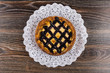 Pie with cottage cheese and jam on paper openwork napkin