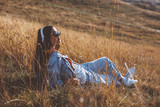 Young woman enjoys the sun in the meadow - 223224961