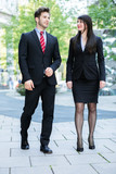 Business partners walking and talking - 223238149