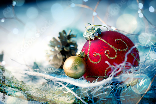 Christmas baubles in snow landscape