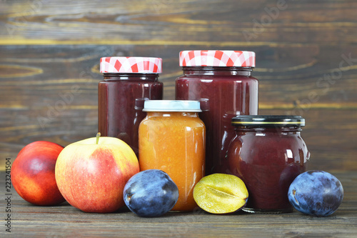 Jam jars on wooden background - 223241504
