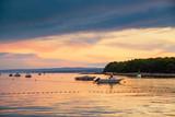 Boat at sunset in Adriatic sea - 223259170