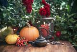 Autumn flowers and pumpkins decor