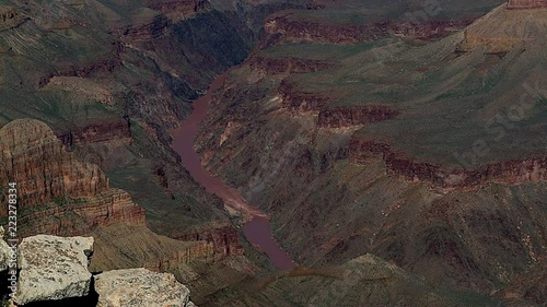 Expansive scene from cliff looking down to the river and beyond of the Grand Canyon