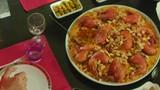 Mediterranean Food . Top-down view, Woman serving Mediterranean Arabic food, Mediterranean salad with Arabic kuba and sambousek, 4k footage - 223300704