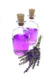 Lavender extract. Aroma of lavender.lavender water in a glass bottle  , branch of fresh lavender isolated on a white background.Natural Herbal Cosmetics - 223301362