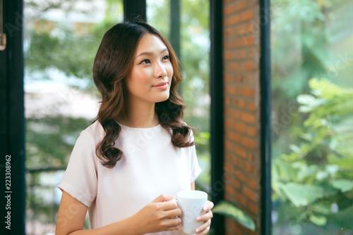 Beautiful woman standing near windows. Beautiful morning - 223308962