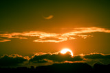 Bright big sun on the sky with clouds - 223315556