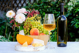 Bottle of wine on a table, summer outdoors. Picnic concept. - 223318397