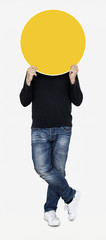 Man holding a round yellow board © Rawpixel.com