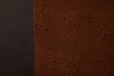 top view of delicious brown cocoa powder on black background - 223336781