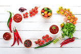 Preparation of tomato sauces and seasonings. Cherry tomatoes, spices, chili peppers. Top view. On a white wooden background. Free copy space. - 223337594