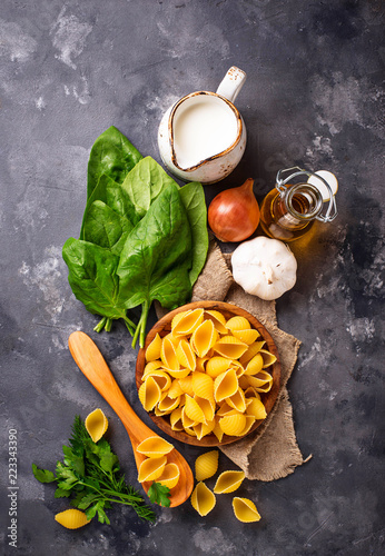 Fototapeta Ingredients for cooking pasta with spinach