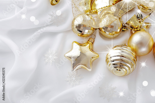 Gold Christmas Ornaments On White Background