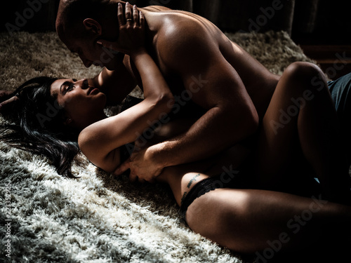 Leinwanddruck Bild Young beautiful couple makes love at home