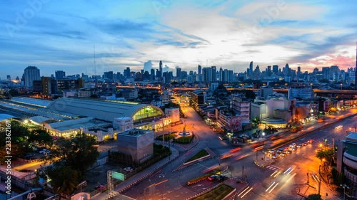 Time lapse High view of city with traffic car in sunrise time / Good morning Bangkok
