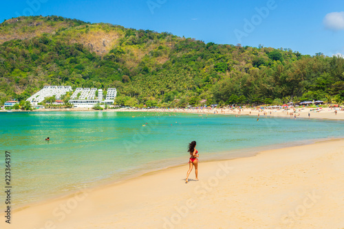Foto Murales Cute woman relaxing on the summer beach.