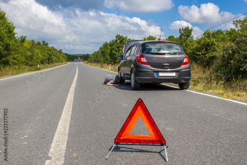 Car malfunction on countryside  Car waiting for help on the road
