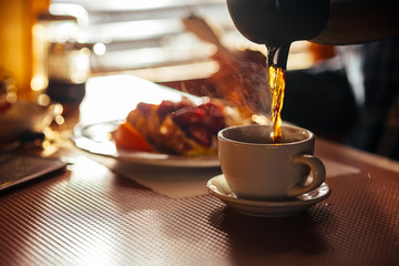 Waitress Pouring Fresh Coffee At A Classic Breakfast Diner