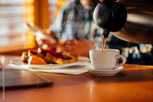 Waitress Pouring Fresh Coffee At A Classic Breakfast Diner © Brendt-Petersen
