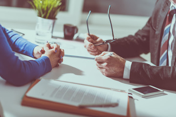 Business negotiation between businesswoman and businessman