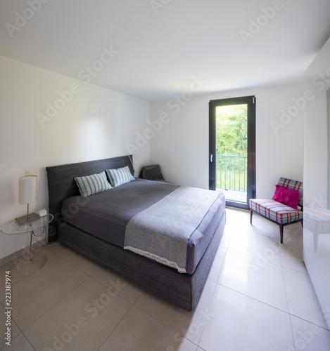 Foto Murales Elegant bedroom with window